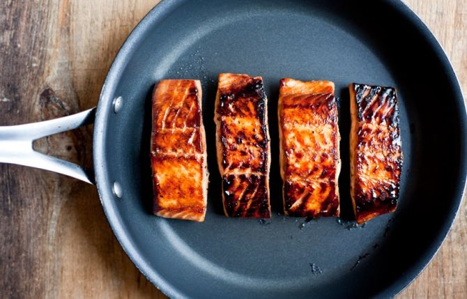 Easy Recipe: Maple Soy Salmon.  This recipe is SUPER FAST to make. The fillets marinate in a mixture of maple syrup, soy sauce, and pepper while the oven preheats. The fillets are panfried for a quick sear then finished in the oven. And so there's no waste the marinade is boiled down and turned into a finishing glaze.  Serve with steamed rice and greens, like broccoli or asparagus. Or, chill the salmon and serve as a starter with crackers, whipped cream cheese, and minced green onion.