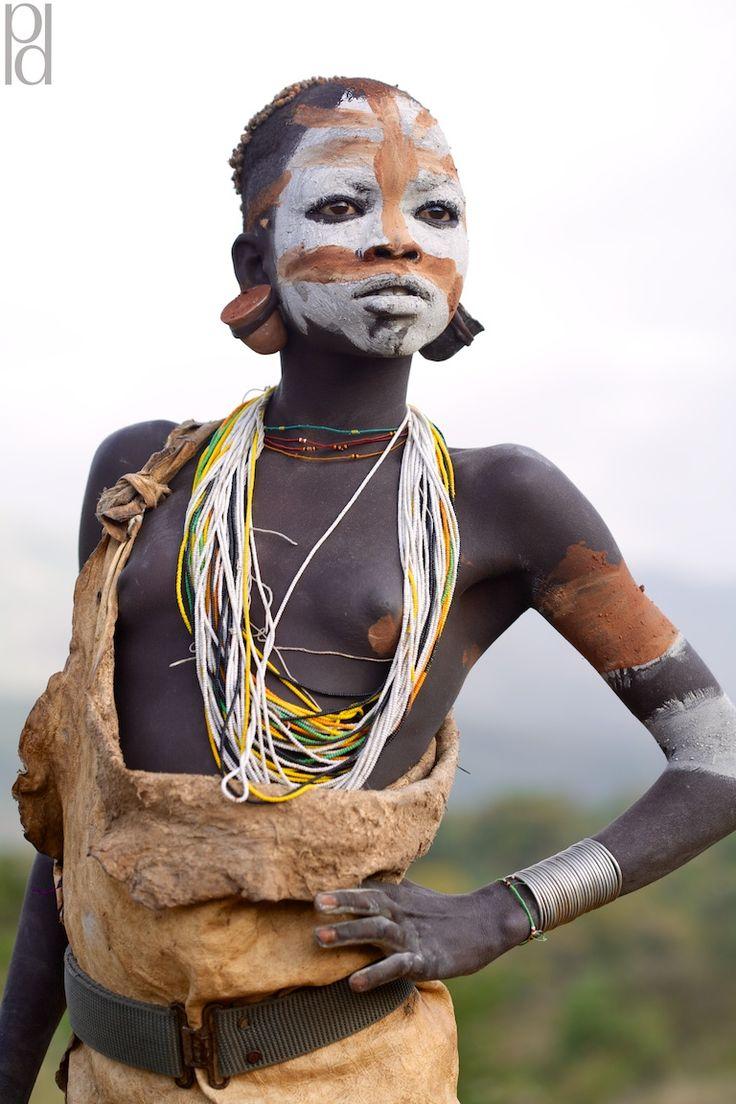 omo valley tribes photos, southern Ethiopia, Surma, Suri, lip plate, scarification, body paint, ceremony, tribe, tribal