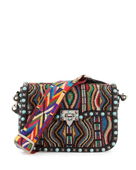 Amazing woven strap on this Valentino bag