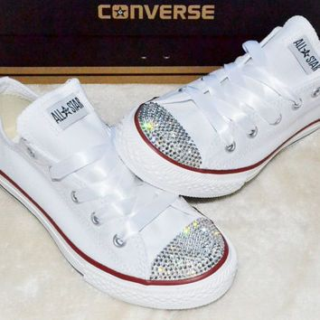 Diamonds are a Girl's Best Friend. Treat your little one to exclusive custom designed Bling Converse sneakers.  Made with Swarovski Crystals not plastic diamonds!   White bling converse with your choi