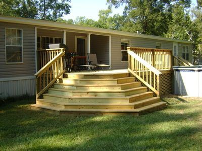 Wood deck with waterfall steps and handrail mobile home - Deck ideas for home ...