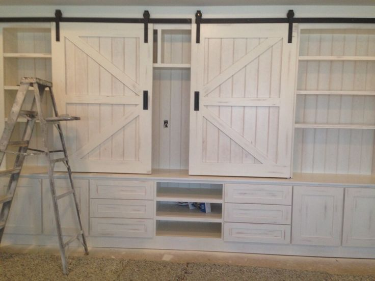 Entertainment center ... Love the barn door hardware