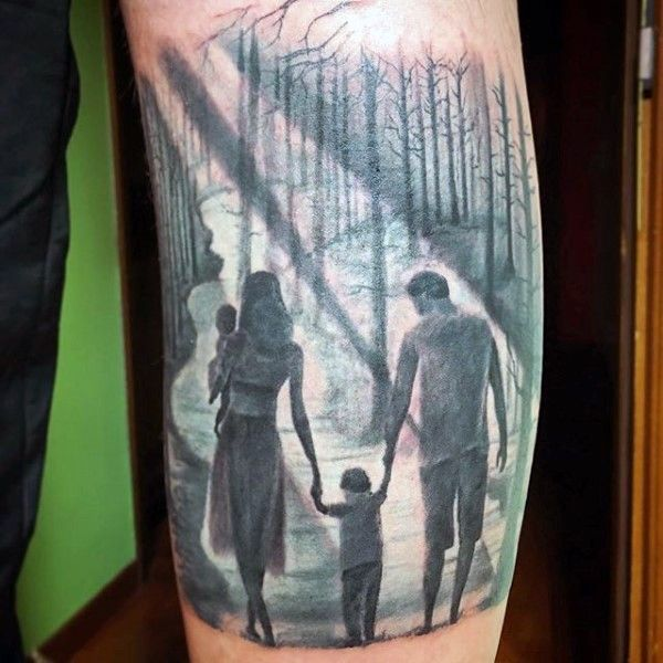 Sweet looking colored walking family in forest tattoo on arm