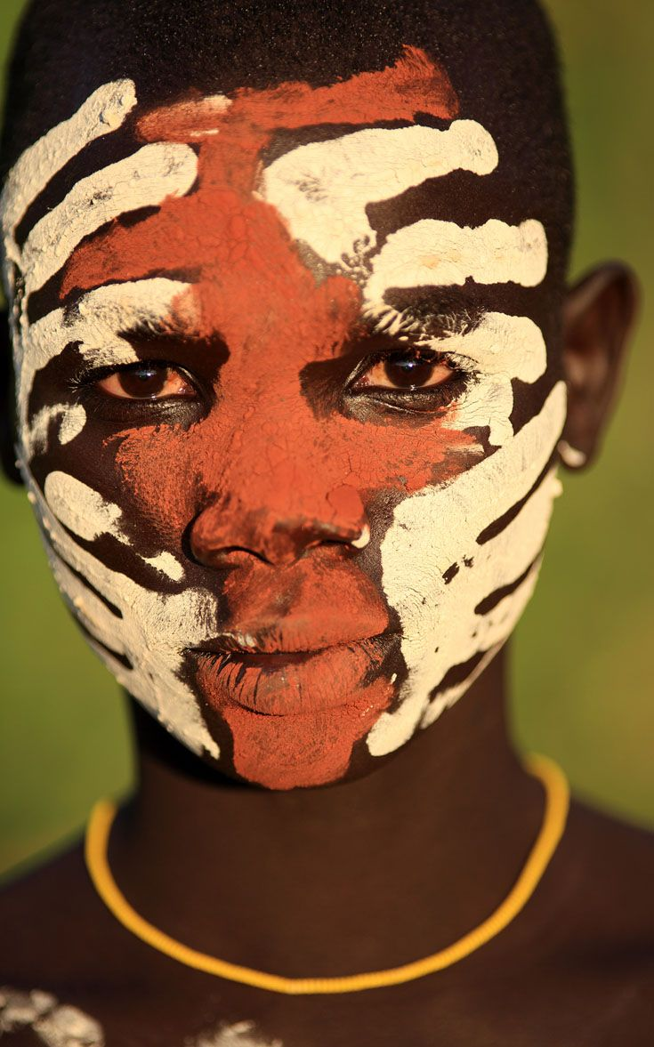 Africa | Young Suri boy with beautiful face painting in Kibish. Omo Valley, Ethiopia | ©Dietmar Temps