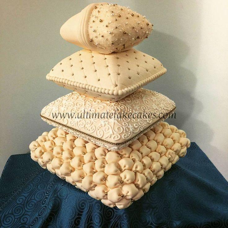 Ivory wedding pillow cake for a Gatsby themed wedding!  #gatsbywedding #ivorycake #vintagecake #gold #fondant #billowcake #pillowcake #filigree #quilted #pearls #weddingcake #4tiercake #ultimatefakecakes #fakecake #weddingbudget #weddingvendor #antiquewhite