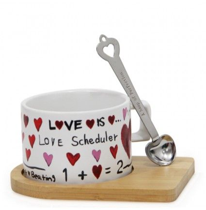 Perk yourself up every morning with this white ceramic coffee mug that is a real treat. It is adorned with a stylish spoon and wooden holder so that you do not spill off your drink anywhere. This mug measures 3 X 2.5 inches in size and made up of ceramic in a classic mug shape with a sturdy handle for an easy grip.