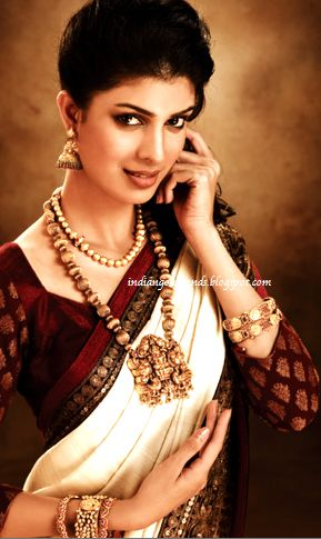Ah, as vintage as it could possibly get. Love it! :) Traditional South Indian Temple Jewellery from http://www.JoyAlukkasIndia.com/