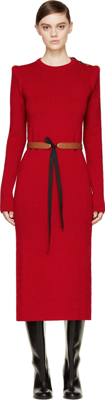 Long sleeve sweater dress in red puckered knit wool. Midi length skirt with split vent at back. Gold-tone round decorative buttons at shoulder seam. Ribbed knit crewneck collar and sleeve cuffs. Tonal stitching. $598