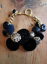 Black and gold vintage button charm bracelet. Repurposed reinvented jewellery available to buy at www.ruralmagpie.co.uk