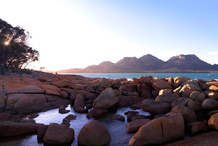 The Saffire Freycinet hotel in Tasmania, Australia, benefits from its natural setting, thousands of years in the making. Indeed, suites and facilities alike command irresistible views back over the wild bushland and out onto its coastal setting. Here, the Hazards Mountains look out over the Great Oyster Bay in a meeting of golden sands and azure waters.