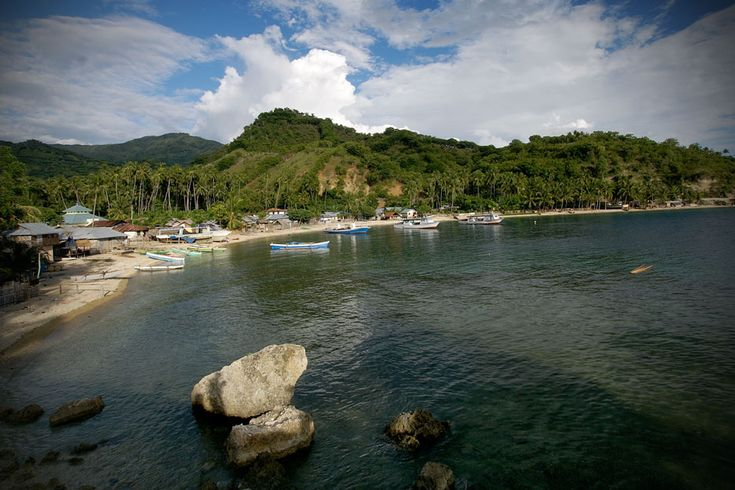 An enchanting afternoon at the calm white sandy beach in Gorontalo, Sulawesi