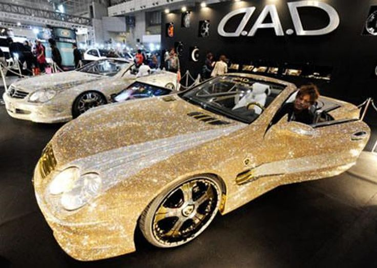 Whoa, that is some sparkle! The car is covered in real diamonds, now that's riding fancy.