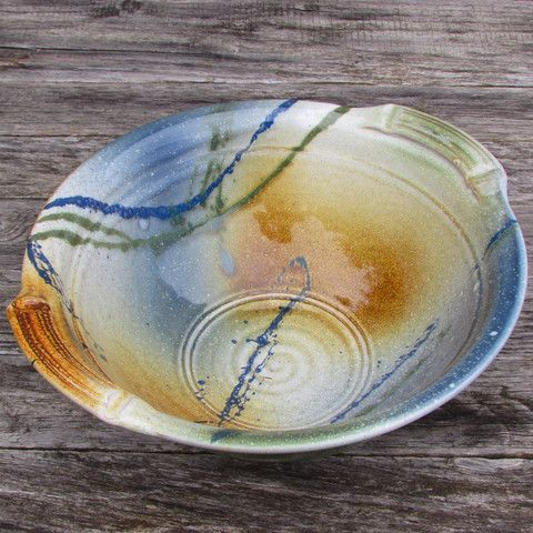 "Handcrafted using blended Irish clay from 30 year old proprietary recipes Some amazing features of this large serving bowl: - Exclusive design of Kiltrea Pottery Ireland - Great size at 10.5"" diameter"