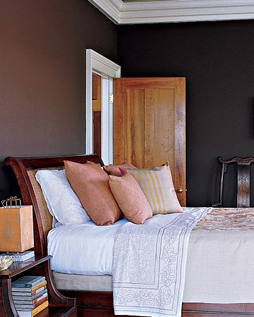 """Velvety, Intimate"" Wall Coloror the way paint ""gets really absorbed into the walls of old places"" prompted her to treat the guest room with a deep, matte chocolate. ""I wanted it to feel velvety and intimate,"" she says. Accent colors like the pale greens and oranges of the antique crewelwork bedspread keep the darkness from becoming overwhelming. The overall effect makes it a very restful spot"