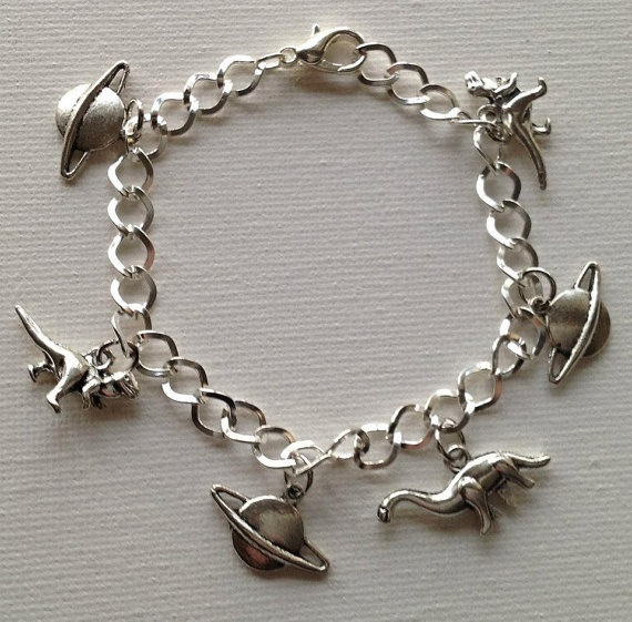 Space and Dinosaurs Charm Bracelet by Mogglepops on Etsy, €12.00