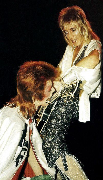 "David Bowie and Mick Ronson in ""that"" pose on the Ziggy Stardust tour"