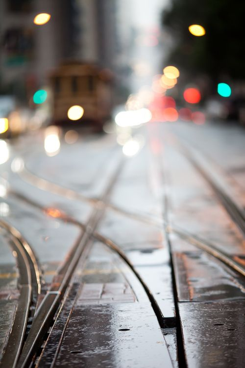 San Francisco trams/ cable cars. Points close-up, soft focus street background with tram