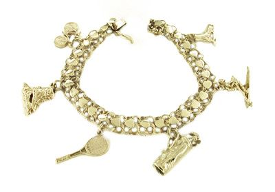 Sports Theme Charm Bracelet in 14 Karat Yellow Gold | Unique Charm Bracelet. Bicycle,rollerblade,tennis,golf,skier, and ice skate are all represented on this fun charm bracelet.