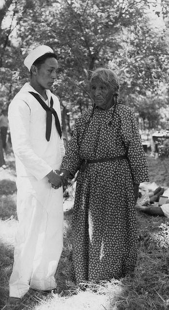 Seaman David Crazy Thunder (Oglala) and mother, Pine Ridge Indian Reservation, South Dakota, 1945.  Marquette University Archives