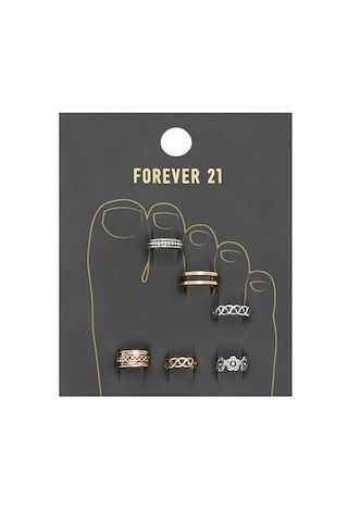 A set of high-polish and burnished toe rings with cutouts, etching, and a floral design.
