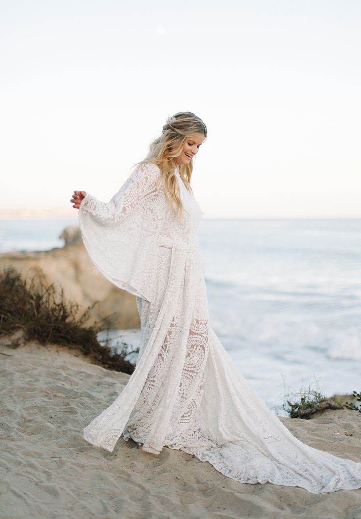 boho lace wedding gown - http://ruffledblog.com/malibu-coastal-bohemian-wedding-inspiration