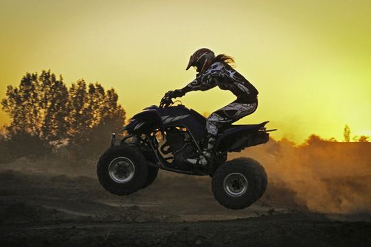 Girl getting air with her atv at sunset | Flickr - Photo Sharing!