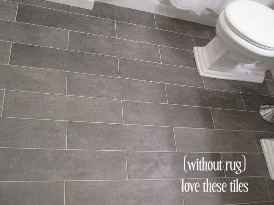 Bathroom tile--tiles: Crossville Ceramic Co from The Great Indoors, 6x24 planks (color: Lead) promo $9/sq ft (originally $14/sq ft) floor grout: Lowe's (warm gray).... great remodel