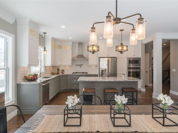 For sale: $404,900. Farmington's newest, luxury townhome community. These elegantly styled homes feature an abundance of rich amenities such as granite countertops, hardwood floors, gas fireplace, and open floor plans. Enjoy the carefree lifestyle with By Carrier's 5-Year Warranty and energy smart homes.