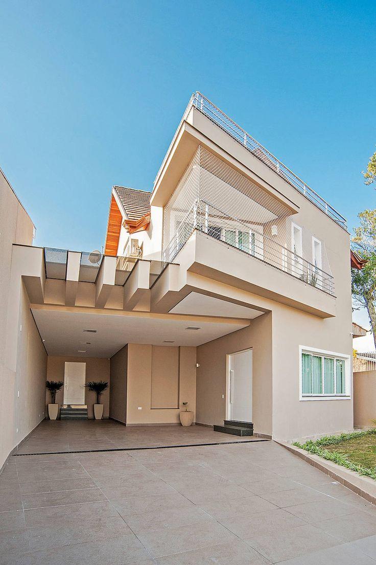Casa com traços geométricos : Case moderne di Patrícia Azoni Arquitetura + Arte