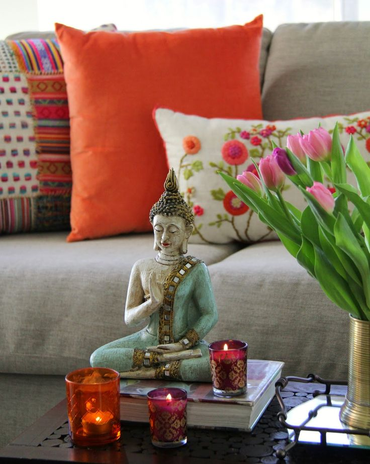 East Coast Desi home tour - mixed prints in pillows and India colors and Buddha. Gorgeous!