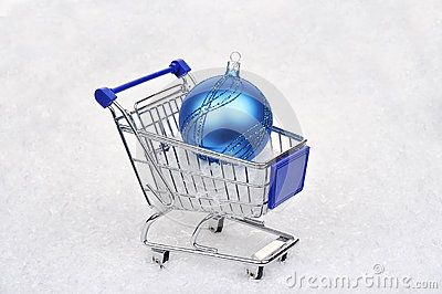 Shopping cart with blue christmas ball