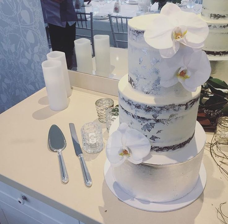 Naked cake with silver leaf and phalaenopsis orchids #nakedcake #wedding #silverleaf #silverleafcake #nakedcake #white #orchids #phalaenopsis #elegant #stunning // cake and photo by: @eversosweetcakes