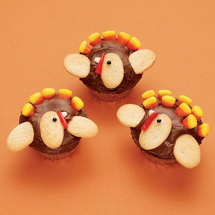 Sweet T.O.M. Turkeys  Candy corn plumes and shortbread wings turn cupcakes into irresistible turkey sweets for Thanksgiving.