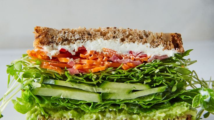 We like veggie sandwich recipes that send juices running down to our elbows, which is why we insist on dressing the lettuce. If you want to use store-bought giardiniera, skip the first step.