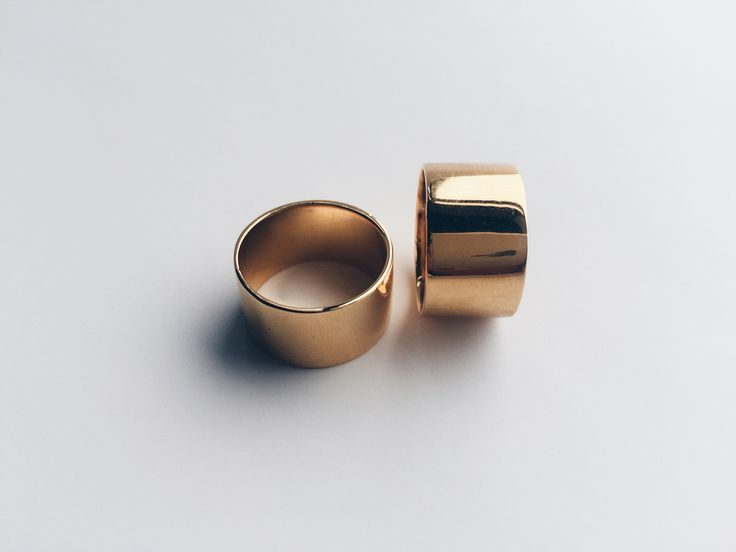 The little black dress of rings. Every lady needs a simple, thick gold band in her collection. This is an 18k gold plated 6 millimeter band perfect for literally any finger. - 6mm band - 18k gold plat