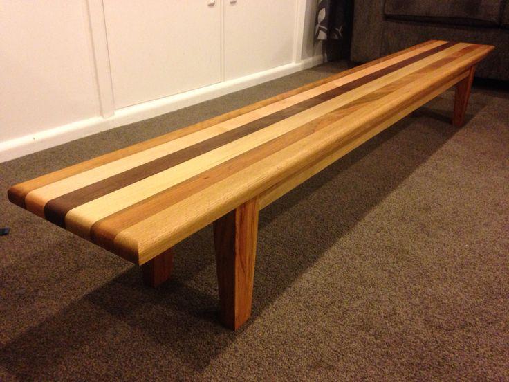 Toddler bench. Rimu legs, oak rails and top is made of oak, rimu, Fijian kauri, black walnut, red beech, iroko.
