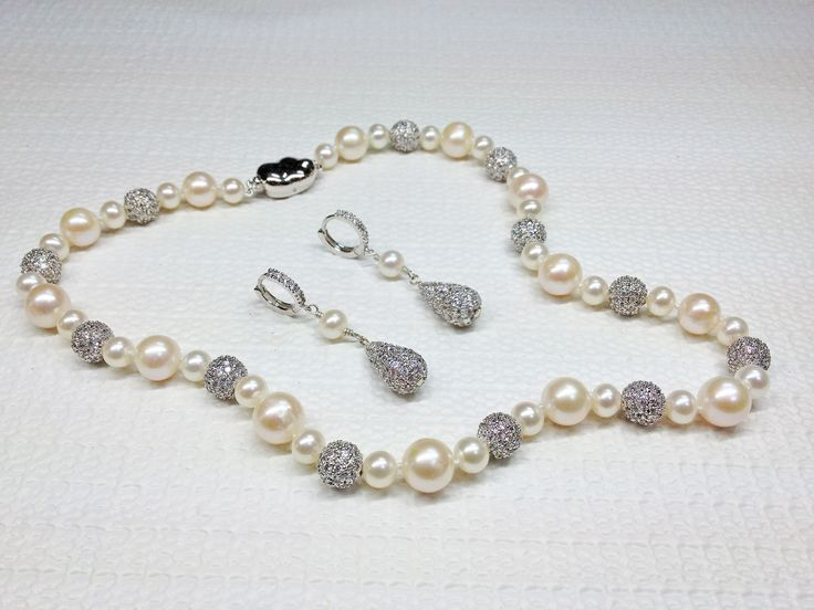 #Bridal #Jewelry made with Freshwater #Pearls with Sterling #Silver and #Cubic Zirconia Beads. #Necklace with matching #earrings, perfect for #weddings or other formal occasions!