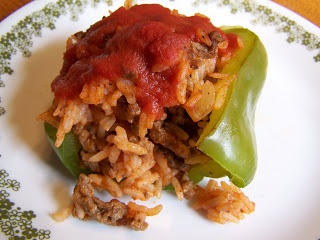 Easy Stuffed Peppers 4 large green bell peppers 4 cups cooked rice (I do about 1 cup per person) 2 cans tomato sauce 1 lb ground beef 1 medium chopped onion 1 clove minced garlic salt and pepper