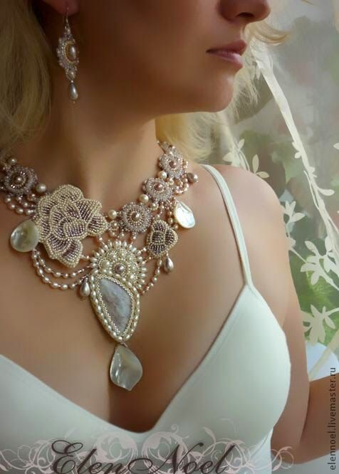 fabric combined with jewellery to create an elegant and intricate design that lays flat on the neck and chest. fabric manipulation flowers produce a neutral element to the accessory and compliments a bare white dress.