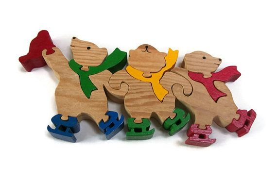 This vintage wooden jigsaw puzzle shows three festive bears wearing winter scarves and ice skates. The puzzle measures 9 inches long, 4 inches tall, and is 3/4 inch thick. It is thick enough that it can also stand up for display. The same image is painted on both side. This does have some smaller pieces so supervision for young children is recommended.