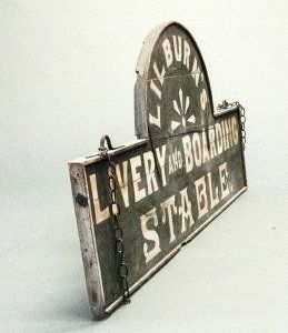 """Vintage 19th Century Stable Sign """"Lilburn's Livery and Boarding Stable."""" Wood and iron with expected wear."""