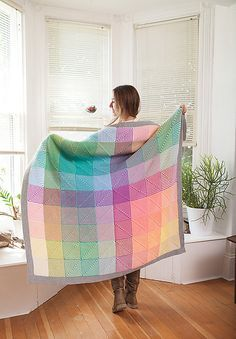 The Hue Shift Afghan blends eleven colors of Brava Sport harmoniously in this unique and crafty mitered afghan. Knit in four larger pieces and then seamed together, each of the four sections begins at the corner and mitered squares are picked up and knit directly onto the existing work. By combining this clever construction with simple garter stitch knitting, you are able to create a modern and visually stunning motif with minimal effort!