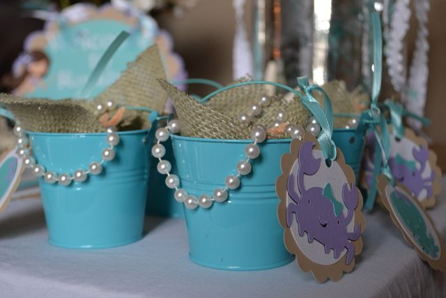Favor buckets at a Mermaid Party - s - perfect color bucket, sometimes you can get these at target for $1. Pearls are must! Burlap looks really cute