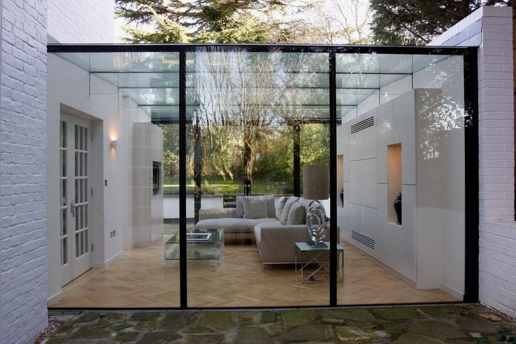 contemporary glass house exterior with french doors portable awnings and shade sails