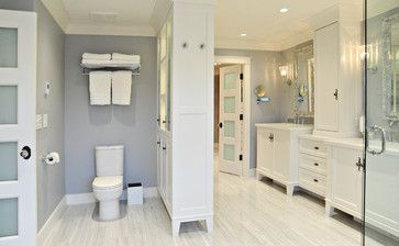 Like the privacy of the toilet without a door but a divider wall and like the cupboards separating the sinks