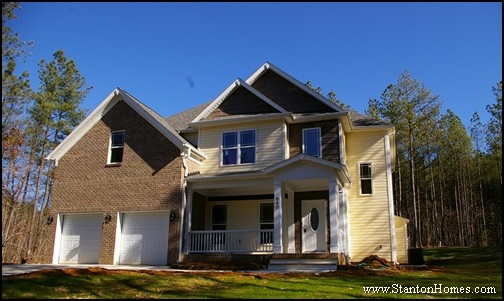 Two Story New Home With Cozy Covered Front Porch Brick