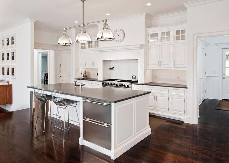 dark wood floors kitchen pictures | The white kitchen with gray counters and stainless appliances leans is ...