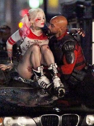 Will Smith plays the character Deadshot in the DC Comics movie, Suicide Squad (pictured with Margot Robbie as harley Quinn)