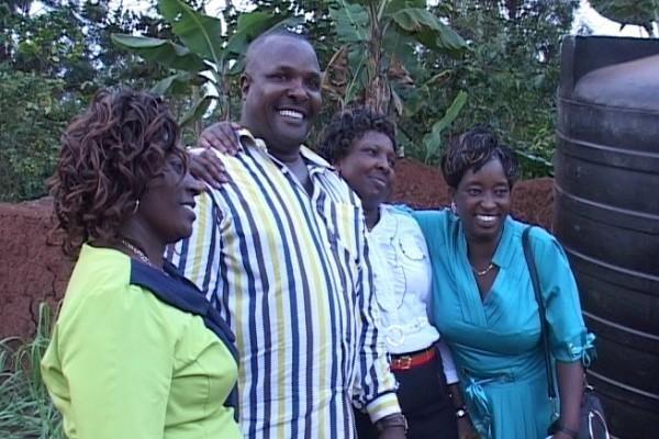 Charles Macharia and his three wives Fresha Nyambura, Esther Nyaguthii and Agnes Wambui, during Nyambura's dowry ceremony in Murang'a town last Saturday. Photo/JAMES WAINAINA
