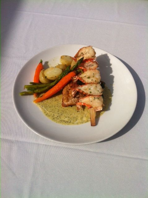Grilled local chicken breast set in pesto cream sauce then topped with a green tiger prawn skewer. Served with buttered spinach, baby carrots and new white potatoes available at the Westward Ho!